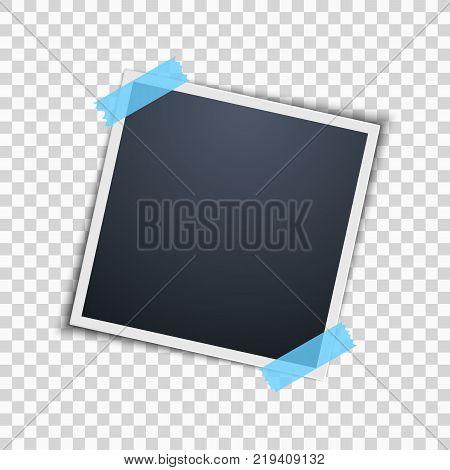 Empty photo frame on a transparent background. Blue scotch tape. Vector illustration.