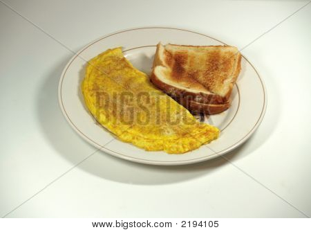Omelet And Toast On Plate