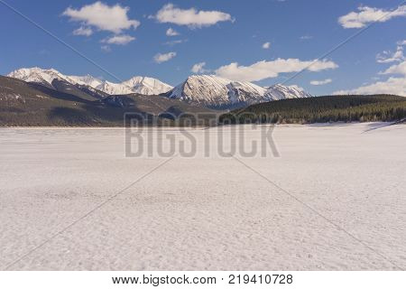 Abraham Lake covered in snow with mountains in the background Alberta Canada.