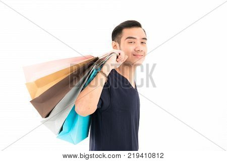 Young Confident Attractive Asian Blue Shirt Man With Shopping Bags Standing With Portrait On White B
