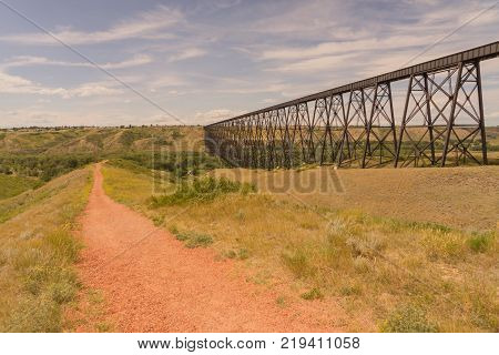 Landscape of High Level trestle train bridge with a walking path in Lethbridge Alberta Canada.