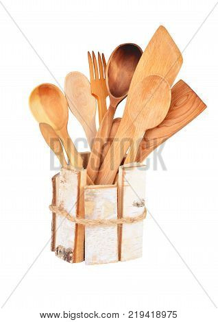 Set of wooden kitchen utensils isolated on white background