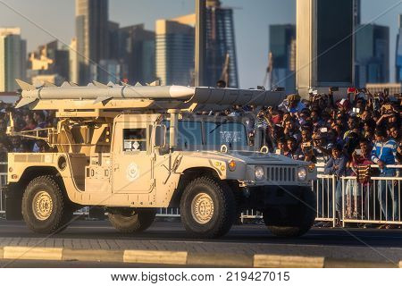 Doha, Qatar - December 18, 2017: Perform of military and civil machines on Qatar National Day parade on the Corniche street, Doha, Qatar