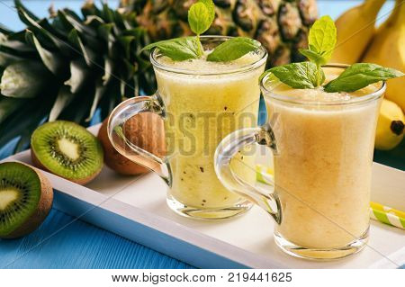 Healthy smoothie with pineapple, kiwi fruit and bananas.