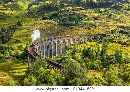Glenfinnan Railway Viaduct in Scotland with the Jacobite steam train passing over
