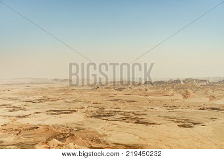 View on the nature of israel negev desert. Sand, stones and rocks outdoor. Colorful geographic volcanic formation