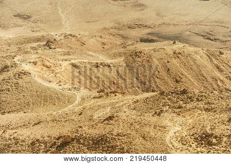 Landscape of paths of the israel negev desert. Outdoor land of stones, rocks and sand. Summer in the middle east