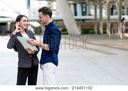 Sale Woman Trying To Sell Insurance To Potential Male Client.