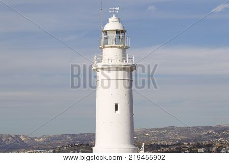 Lighthouse in the background of the sky in the town of Paphos Cyprus