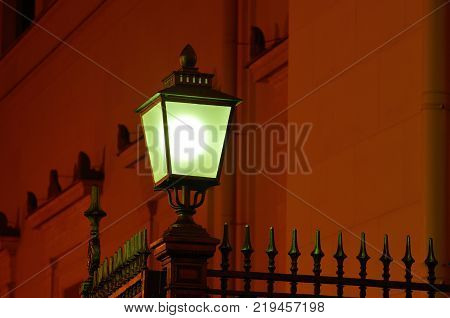 an electric lamp illuminates the street at night.In order that people would not get lost.