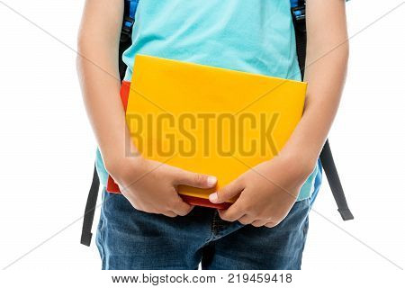 Smiling Schoolboy With Backpack And Book Posing Against White Background In Studio