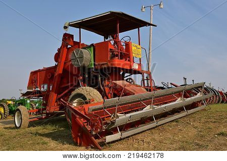 ROLLAG, MINNESOTA, Sept 1, 2017: A vintage self propelled Harris Combine with  horiziontally adjustable header and wheel is being displayed at the annual WCSTR farm show in Rollag held each Labor Day weekend where 1000`s attend.