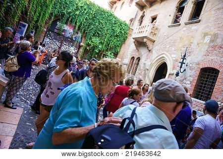VERONA, ITALY - AUGUST 27, 2017: Streets and buildings of Verona city at the sunny summer day.  Because of the value of its historical buildings, Verona has been named a UNESCO World Heritage Site