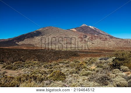 Teide National Park, Tenerife, Canary Islands - A picturesque view of the colourful Teide volcano, or in spanish 'Pico del Teide'. The tallest peak in Spain with an elevation of 3718 m.