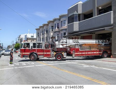 sunny street scenery including a fire engine at a fire department in San Francisco