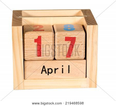 Wooden letters in isolated calendar showing tax day for filing is April 17 2018