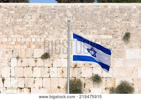 Macro and horizontal picture of The Placing Notes in the Western Wall the Kotel at Jewish Quarter inside the walls of Old City in Jerusalem Israel