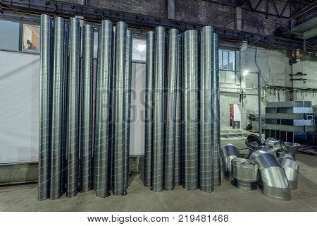 Steel pipes and other parts for construction of ducts of industrial air condition system in the warehouse.