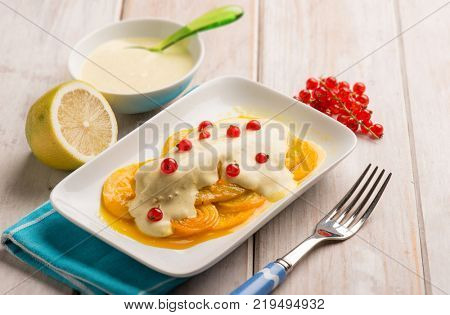 fish fillet with curry sauce onions and redcurrant