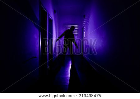 Dark Corridor With Cabinet Doors And Lights With Silhouette Of Spooky Horror Man Standing With Diffe