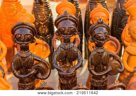 Clay made dolls terracotta handicrafts tribal art of Bankura and Bishnupur on display during the Handicraft Fair in Kolkata West Bengal India. It is the biggest handicrafts fair in Asia.