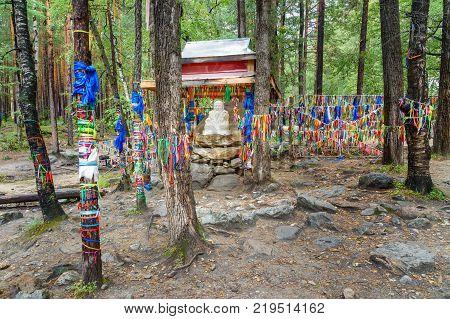 Statue Sagaan Ubgen White Old Man is near Source of mineral water in Arshan. Buryatia. Russia