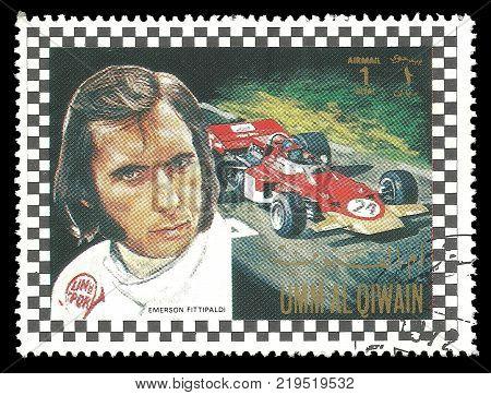 Umm al Quwain - circa 1972: Stamp printed by Umm al Quwain Color edition on topic of Car Racing shows Racing driver Emerson Fittipaldi from Brasil circa 1972
