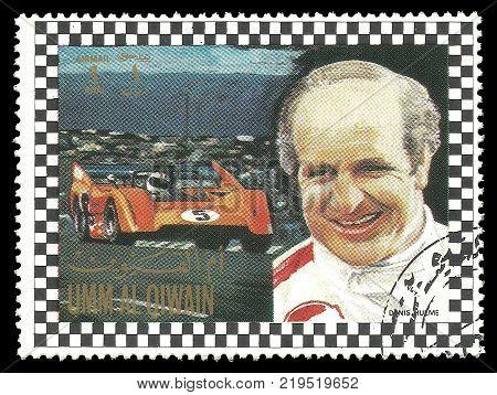 Umm al Quwain - circa 1972: Stamp printed by Umm al Quwain Color edition on Car Racing shows Racing driver Denis Clive Hulme from New Zealand circa 1972