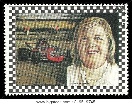 Umm al Quwain - circa 1972: Stamp printed by Umm al Quwain Color edition on topic of Car Racing shows Racing driver Bengt Ronald Peterson from Sweden circa 1972