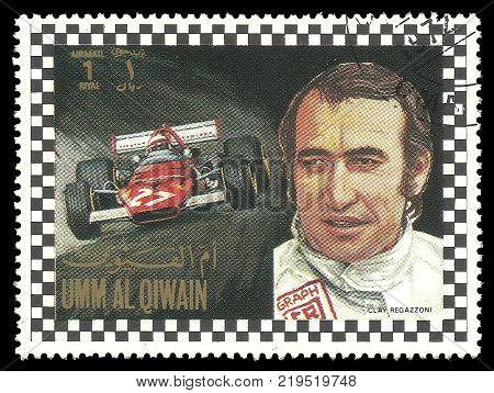 Umm al Quwain - circa 1972: Stamp printed by Umm al Quwain Color edition on Car Racing shows Racing driver Gian Claudio Giuseppe Regazzoni from Switzerland circa 1972