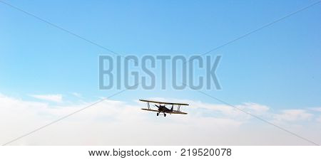 Biplane in the sky in the air