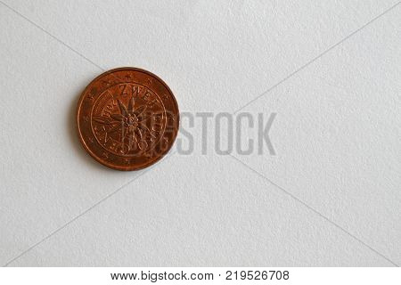One Euro Coin Lie On Isolated White Background Denomination Is 2 Euro Cent - Back Side
