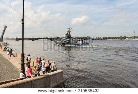 St. Petersburg, Russia - 28 July, People watching the parade, 28 July, 2017. Festive parade of warships on the Neva River in St. Petersburg.