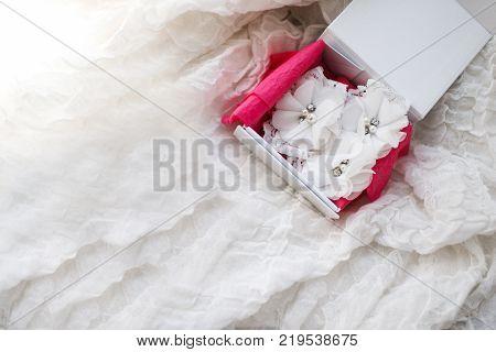 Beautiful wedding white bridal garter. Wedding day moments.