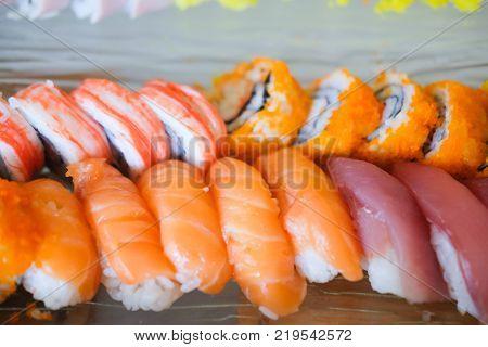Various Kinds Of Sushi Served. Sushi Set Sashimi And Sushi Rolls