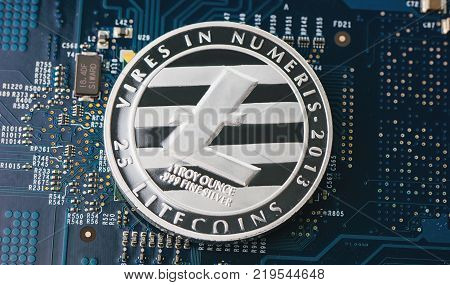 Single litecoin on a mainboard litecoin is the new virtual internet money Digital cryptocurrency