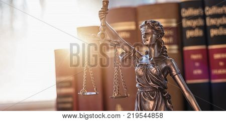 Statue of Justice - lady justice or Iustitia / Justitia the Roman goddess of Justice with in a lawyer office. ideal for websites and magazines layouts