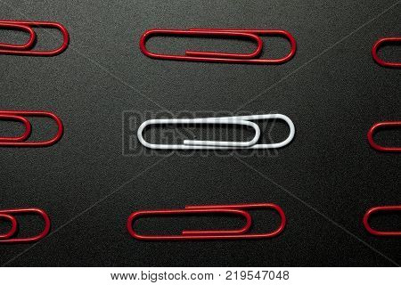 row of paper clip on black background different concept