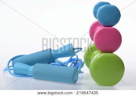 Dumbbells In Bright Green Color, Water Bottle And Measure Tape