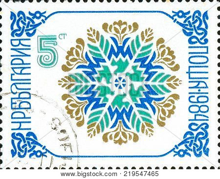 Ukraine - circa 2017: A postage stamp printed in Bulgaria shows drawing floral ornament in the form of snowflakes. Circa 1984.