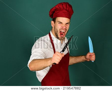 Food Preparation. Chef With Strict Face Holds Lettuce And Cabbage