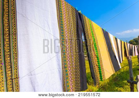 Colorful Thai Sarongs Fluttering In The Wind, On The Rice Field Meadow