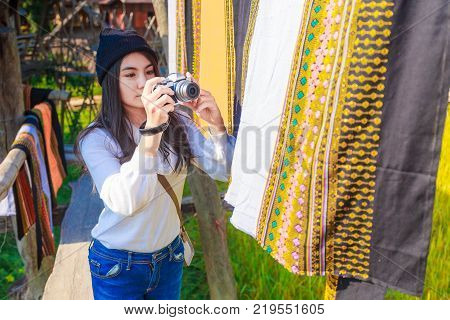 Asian Woman Taking Photo Colorful Thai Sarongs Fluttering In The Wind