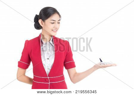Portrait Of Asian Air Hostess Holding Airplane Model With White Background, Woman Stand And Smile At