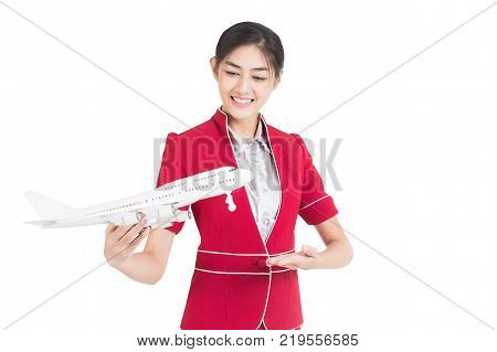 Portrait Of Asian Air Hostess Holding Airplane Model And Passport, Woman Stand And Smile, Woman With