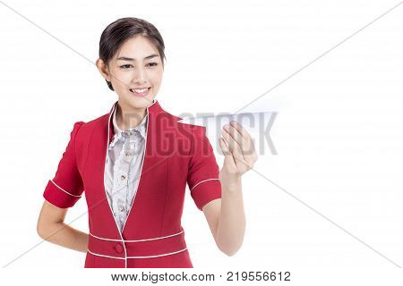 Portrait of Attractive Asian Air Hostess holdong paper airplane with White background Woman stand and smile at isolated on white background Woman with Air Hostess concept.