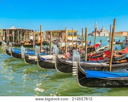 VENICE, ITALY - SEPTEMBER 6 2013: Gondolas moored in the Venetian lagoon. Venice, Italy