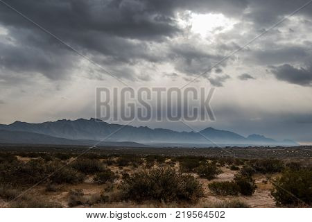 Franklin Mountains, El Paso, Texas under dark cloudy sky