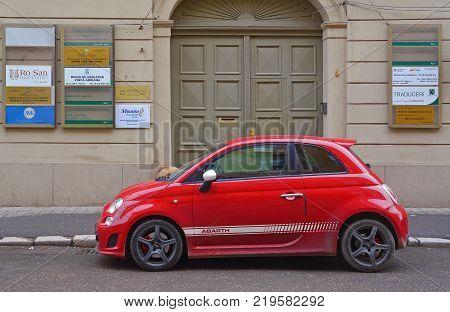 Timisoara Romania - December 24 2017: Red car parked on the street. Shot taken on December 24th 2017