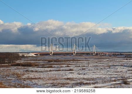 Autumn landscape with a view of the cable-stayed bridge on the river Oka Murom Russia.